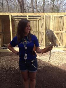Arrianne is pictured with Louie, a eurasian subspecies of Barn Owl and permanent resident of the Glen Helen Raptor Center in Yellow Springs, OH.