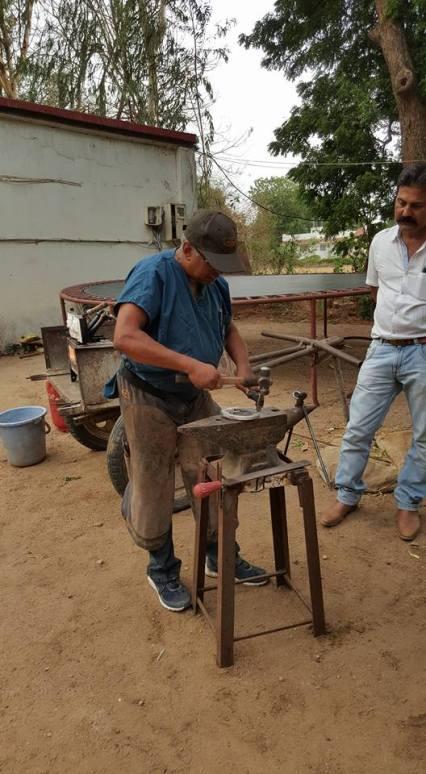 Dr. Ramu making a horseshoe.